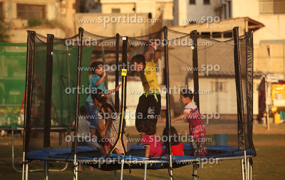 Palestinian children play at the Gaza seaport, Palestine on 2015/07/06. EXPA Pictures &copy; 2015, PhotoCredit: EXPA/ APAimages/ Ashraf Amra<br /> <br /> *****ATTENTION - for AUT, GER, SUI, ITA, POL, CRO, SRB only*****