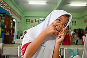 "Sept. 27, 2009 -- PATTANI, THAILAND: Elementary school class at the Gahong School in Pattani, Thailand Sept. 27. Schools and school teachers have been frequent targets of Muslim insurgents in southern Thailand and the army now provides security at many government schools.  Thailand's three southern most provinces; Yala, Pattani and Narathiwat are often called ""restive"" and a decades long Muslim insurgency has gained traction recently. Nearly 4,000 people have been killed since 2004. The three southern provinces are under emergency control and there are more than 60,000 Thai military, police and paramilitary militia forces trying to keep the peace battling insurgents who favor car bombs and assassination.  Photo by Jack Kurtz / ZUMA Press"