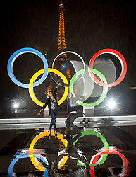 © Licensed to London News Pictures13/09/2017 Paris, France.  <br /> <br /> 13 September 2017, Trocadero Paris (France): A gendarme indulges a couple with VIP passes to be amongst the first photographed dancing in front of the newly unveiled Olympic Rings. The IOC (International Olympic Committee) formally announce the host of the 2024 Summer Games awarding Paris the distinction.<br /> Photo credit: Guilhem Baker/LNP