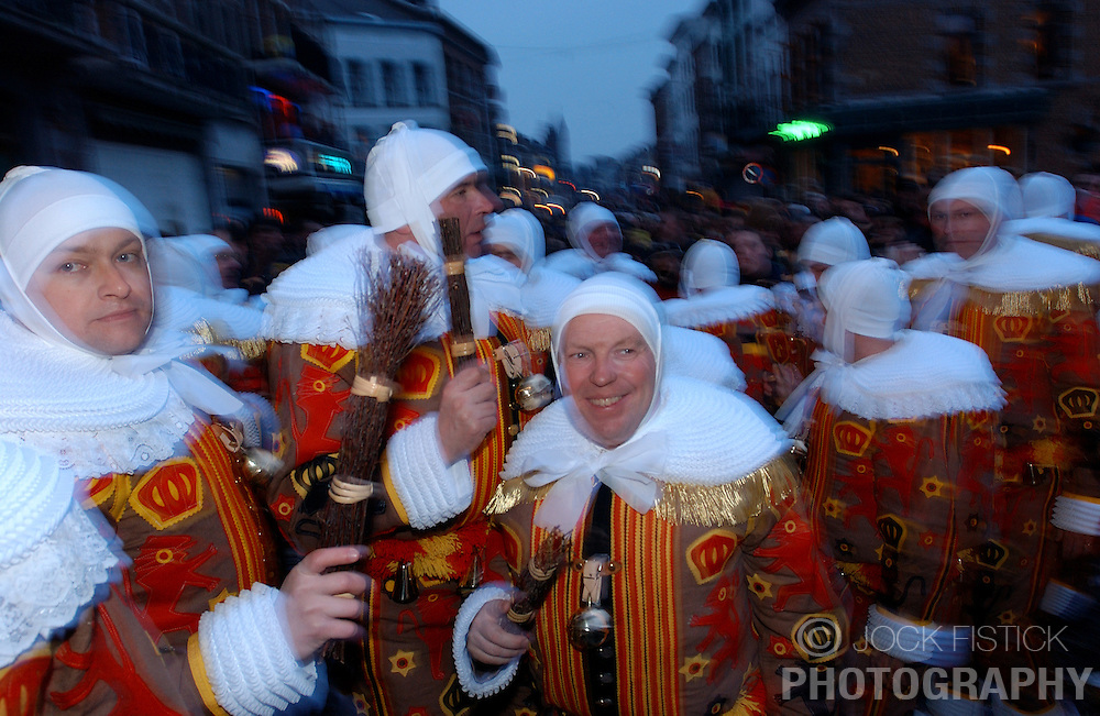 """BINCHE, BELGIUM - FEB-24-2004 - The Carnival of Binche was recently recognized by UNESCO as a """"Masterpiece of the Oral and Intangible Heritage of Humanity"""". With roots going back to the Middle Ages, Binche's famed celebration ranks as one of Europe's oldest surviving street carnivals. The carnival culminates on Mardi Gras when the legendary Gille characters make their dramatic appearance. The day starts at 2 a.m. with the Gilles getting dressed in their homes and then parading through the streets collecting followers and stopping at the homes of other Gilles for snacks of raw oysters and champagne, before descending in mass on the town square."""