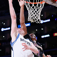 10 April 2014: Minnesota Timberwolves forward Robbie Hummel (4) goes for the layup over Los Angeles Lakers forward Ed Davis (21) during the Los Angeles Lakers 106-98 victory over the Minnesota Timberwolves, at the Staples Center, Los Angeles, California, USA.