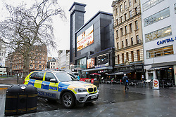 © licensed to London News Pictures. London, UK 07/02/2014. Police officers patrolling in Leicester Square after a body has been found close to Leicester Square in central London  on Thursday, 6 February 2014. The body is believed to be missing Irish teenager Patrick Halpin who was last seen in the area on Tuesday, 4 February 2014. Photo credit: Tolga Akmen/LNP