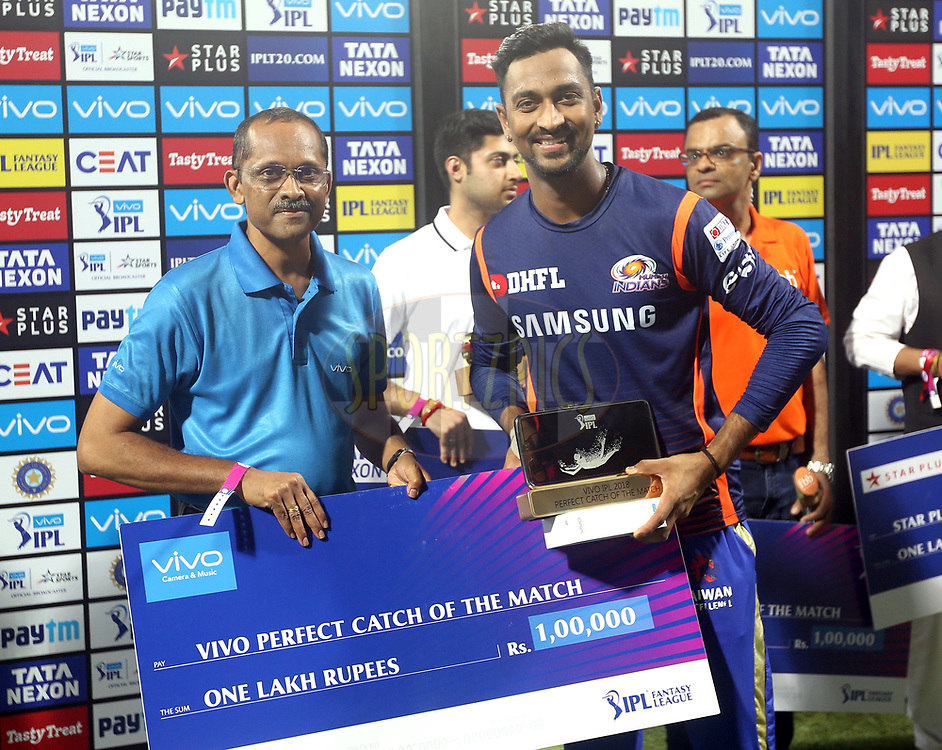 Krunal Pandya of the Mumbai Indians receives the Vivo Perfect Catch of the match award during the presentation of the match thirty seven of the Vivo Indian Premier League 2018 (IPL 2018) between the Mumbai Indians and the Kolkata Knight Riders   held at the Wankhede Stadium in Mumbai on the 6th May 2018.<br /> <br /> Photo by: Sandeep Shetty /SPORTZPICS for BCCI