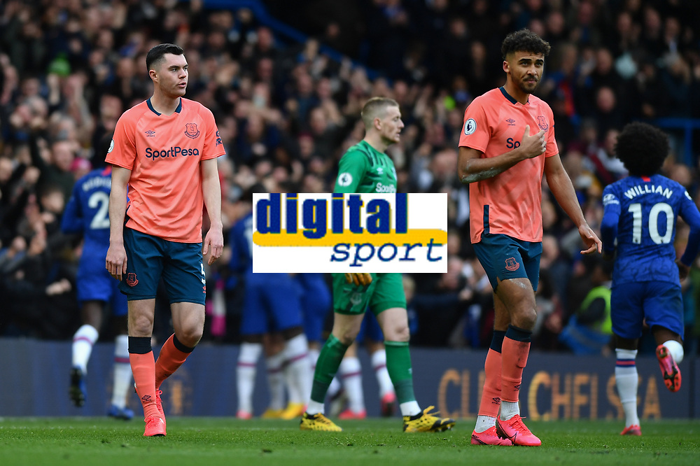 Football - 2019 / 2020 Premier League - Chelsea vs. Everton<br /> <br /> Everton's Michael Keane (left) and Dominic Calvert-Lewin dejected as Chelsea's Olivier Giroud scores his side's fourth goal, at Stamford Bridge.<br /> <br /> COLORSPORT/ASHLEY WESTERN