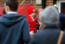 A young Bristol City fan is carried to the ground by his father before the match - Photo mandatory by-line: Rogan Thomson/JMP - 07966 386802 - 25/01/2015 - SPORT - FOOTBALL - Bristol, England - Ashton Gate Stadium - Bristol City v West Ham United - FA Cup Fourth Round Proper.