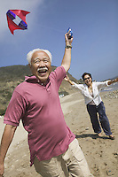 Couple flying kite on Beach
