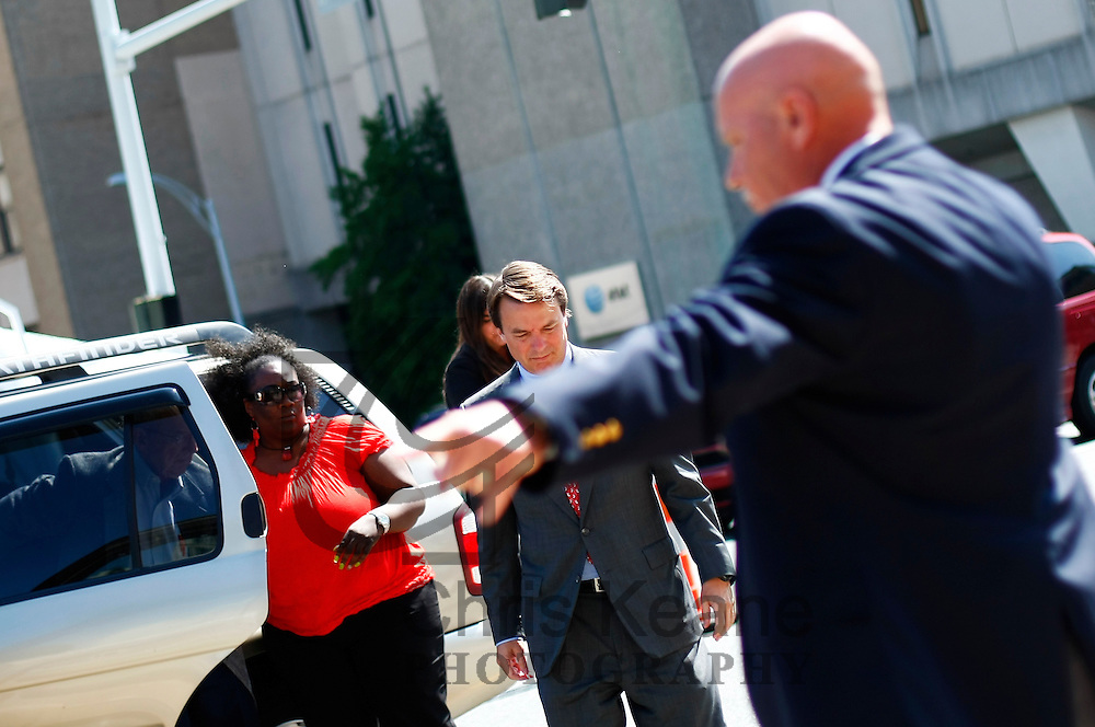 Former U.S. Senator John Edwards arrives at the federal court house as a U.S. Marshal directs foot traffic in Greensboro, North Carolina May 30, 2012. Wednesday is the eighth day of jury deliberations about whether Edwards broke federal campaign finance laws as he tried to conceal an affair while running for president in 2008. REUTERS/Chris Keane (UNITED STATES)