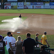 Ground staff prepare the infield before the New Britain Rock Cats Vs Binghamton Mets Minor League Baseball game at New Britain Stadium, New Britain, Connecticut, USA. 2nd July 2014. Photo Tim Clayton