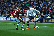 Adam Reach of Preston tries to get around Matthew Lowton of Burnleyduring the Sky Bet Championship match between Preston North End and Burnley at Deepdale, Preston, England on 22 April 2016. Photo by Simon Brady.