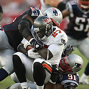 Tampa Bay running back LaGarrette Blount (27) gets tackled by New England defenseive lineman Myron Pryor (91) during an NFL football game between the New England Patriots and the Tampa Bay Buccaneers at Raymond James Stadium on Thursday, August 18, 2011 in Tampa, Florida.   (Photo/Alex Menendez)