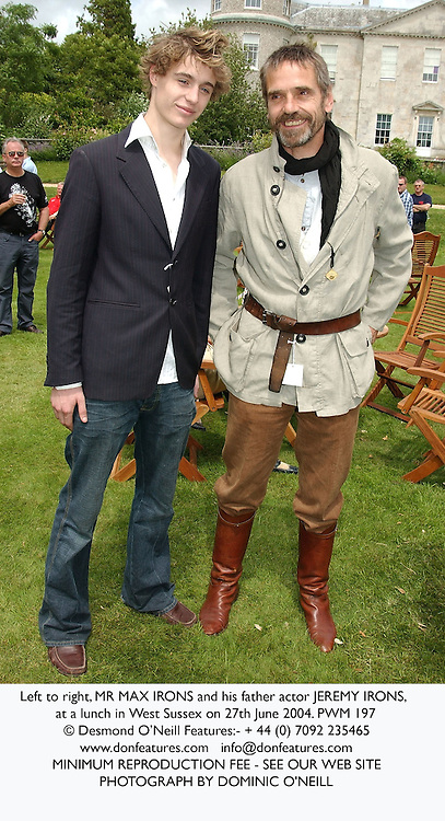 Left to right, MR MAX IRONS and his father actor JEREMY IRONS, at a lunch in West Sussex on 27th June 2004.PWM 197