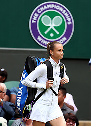 Magdalena Rybarikova walks out for her match against Garbine Muguruza on day ten of the Wimbledon Championships at The All England Lawn Tennis and Croquet Club, Wimbledon.