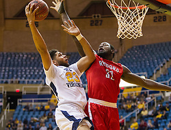 Dec 20, 2016; Morgantown, WV, USA; West Virginia Mountaineers forward Esa Ahmad (23) shoots while defended by Radford Highlanders center Randy Phillips (32) during the second half at WVU Coliseum. Mandatory Credit: Ben Queen-USA TODAY Sports