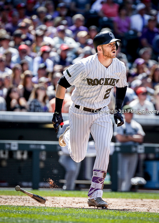 SHOT 5/28/17 2:21:29 PM - Colorado Rockies infielder Trevor Story #27 runs towards first base after a hit against  the St. Louis Cardinals during their regular season MLB game at Coors Field in Denver, Co. The Rockies won the game 8-4. (Photo by Marc Piscotty / © 2017)