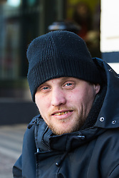 "James, 35, on his pitch outside McDonalds on the High Street opposite Windsor Castle. After a public outcry against their ""homelessness support strategy"" where rough sleepers would have been fined £100, Windsor council has shelved their plans. Windsor, Berkshire, February 16 2018."