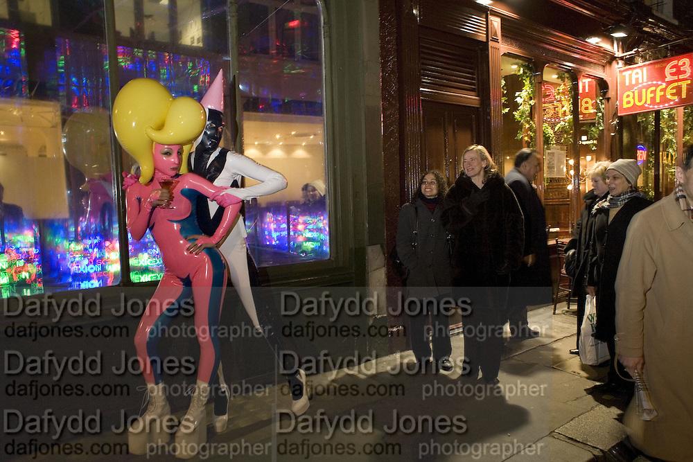 Andrey Bartenev and Sasha Frolova. ( pink) Andrey Bartenev ' Disco-Nexion' Riflemaker. Beak St. Soho. London. 7 January 2008. -DO NOT ARCHIVE-© Copyright Photograph by Dafydd Jones. 248 Clapham Rd. London SW9 0PZ. Tel 0207 820 0771. www.dafjones.com.