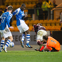 St Johnstone v Hearts..15.12.12      SPL<br /> Jamie MacDonald blocks Gregory Tade's shots at goal<br /> Picture by Graeme Hart.<br /> Copyright Perthshire Picture Agency<br /> Tel: 01738 623350  Mobile: 07990 594431