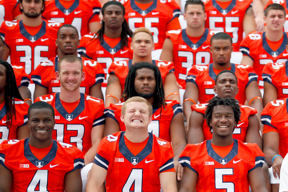 Senior quarterback Reilly O'Toole (4) jokes around while posing for group photos during football media day at Memorial Stadium Sunday, Aug. 10, 2014, on the University of Illinois campus in Champaign, Ill. (Lee News Service/ Stephen Haas)