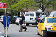 CHICAGO, IL - MAY 17: A panhandler in a bear costume solicits tips outside the stadium following the game between the Chicago Cubs and New York Mets on May 17, 2013 at Wrigley Field in Chicago, Illinois. The Mets won 3-2. (Photo by Joe Robbins)
