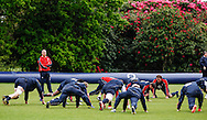 Picture by Andrew Tobin/Tobinators Ltd +44 7710 761829.24/05/2013.Head coach Stuart Lancaster looks on as his players warm up during the England training session at Pennyhill Park, Bagshot ahead of the match against the Barbarians on 26th May 2013.