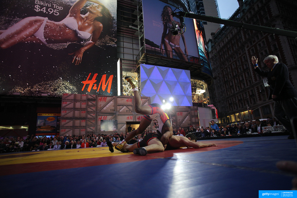 Jordan Burroughs, (top), USA, in action against  Atsamaz Sanakoev, Russia, during the 'Beat The Streets' USA Vs The World, International Exhibition Wrestling in Times Square. New York, USA. 7th May 2014. Photo Tim Clayton