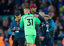 LIVERPOOL, ENGLAND - Sunday, October 7, 2018: Liverpool's manager Jürgen Klopp embraces Manchester City's goalkeeper Ederson Moraes after the FA Premier League match between Liverpool FC and Manchester City FC at Anfield. (Pic by David Rawcliffe/Propaganda)
