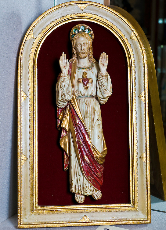 A ceramic of the Sacred Heart, purchased by Auxiliary Bishop John Grellinger during a visit to Rome while attending the Second Vatican Council. (Sam Lucero | The Compass)