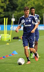 17.07.2013, Trainingsgelaende, Veltins Arena, GER, 1. FBL, FC Schalke 04 Training, im Bild V.l.n.r. Klaas Jan Huntelaar und Michel Bastos ( beide Schalke 04/ Action/ Aktion ), // during a Training Session of German Bundesliga Club Fc Schalke 04 at the Training Ground, Veltins Arena, Germany on 2013/07/17. EXPA Pictures © 2013, PhotoCredit: EXPA/ Eibner/ Thomas Thienel<br /> <br /> ***** ATTENTION - OUT OF GER *****