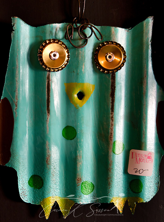 A whimsical owl, made from recycled tin, hangs in the Funky Monkey gift shop Oct. 10, 2011 in Holly Springs, Miss. The store, located inside Tyson Drug. Co., features a number of gift items from Mississippi artisans. (Photo by Carmen K. Sisson/Cloudybright)