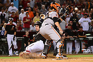 PHOENIX, AZ - MAY 14:  Paul Goldschmidt #44 of the Arizona Diamondbacks safely slides into home in front of Buster Posey #28 of the San Francisco Giants in the eighth inning at Chase Field on May 14, 2016 in Phoenix, Arizona.  (Photo by Jennifer Stewart/Getty Images)