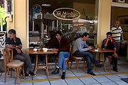 Coffee shop near the main square of Nausa city. One of the functions coffee shops have is to help people meet and make deals for temporary employment oportunities.