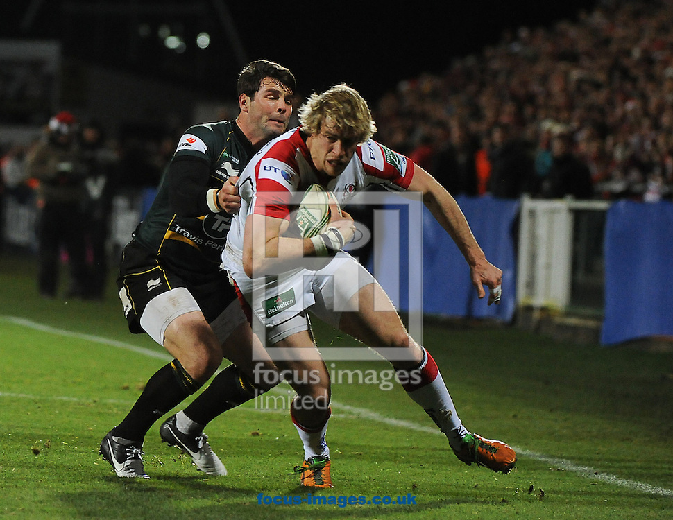 Picture by Ramsey Cardy/Focus Images Ltd +44 7809 235323.15/12/2012.Andrew Trimble of Ulster Rugby is tackled by Ben Foden of Northampton Saints during the Heineken Cup match at Ravenhill Stadium, Belfast.