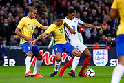 Brazil Paris Saint Germain PSG defender Marquinhos (13) challenges England Manchester United forward Marcus Rashford (11) in the box during the International Friendly match between England and Brazil at Wembley Stadium, London, England on 14 November 2017. Photo by Simon Davies.