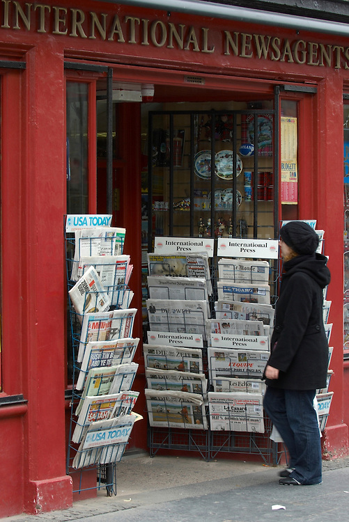 Internation newspapers at a newsagent stand