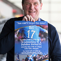 St Johnstone Manager Tommy Wright with a poster promoting the Scottish Cup Final between St Johnstone and Dundee United on May 17th 2014 at Celtic Park.<br /> Picture by Graeme Hart.<br /> Copyright Perthshire Picture Agency<br /> Tel: 01738 623350  Mobile: 07990 594431