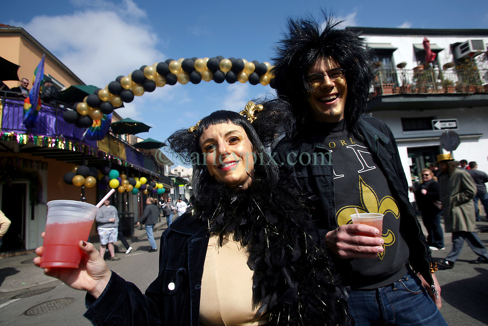 07 February 2010. New Orleans, Louisiana, USA. <br /> Super Bowl XL1V. <br /> Vicki Mayer and Torbjorn Tornquist. New Orleans Saints fans gather in the French Quarter in anticipation of the big game in Miami later in the day as the home team goes head to head with the Indianapolis Colts for Super Bowl 44. <br /> Photo ©; Charlie Varley/varleypix.com