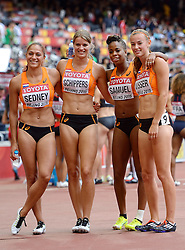 29-08-2015 CHN: IAAF World Championships Athletics day 7, Beijing<br /> Naomi Sedney, Dafne Schippers, Jamile Samuel and Nadine Visser of Netherlands  in the Women's 4x100 Metres Relay heats Photo by Ronald Hoogendoorn / Sportida