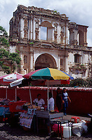 Food stands outside colonial ruins in Antigua, Guatemala
