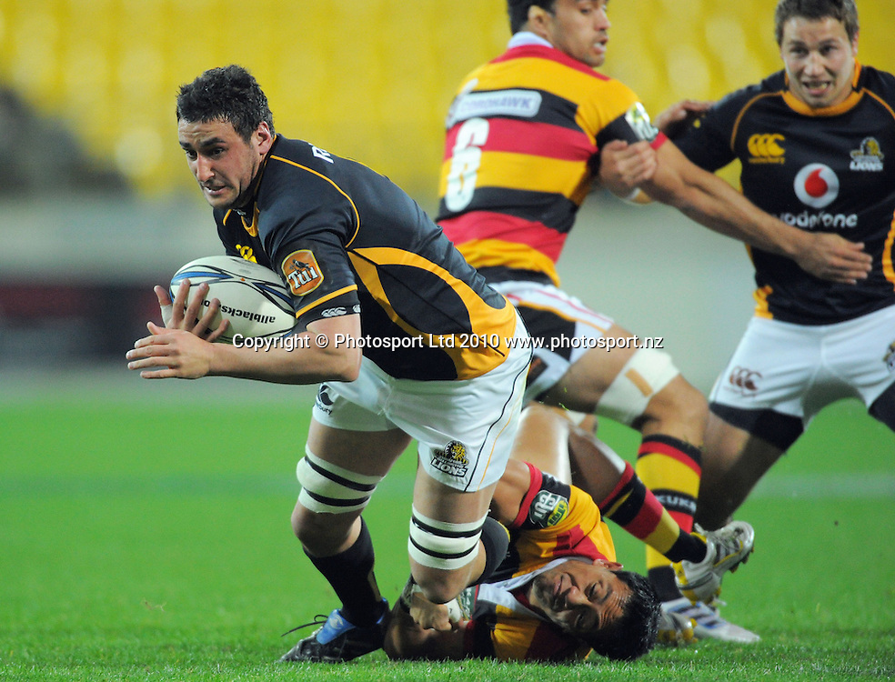 Wellington's Daniel Ramsay is tackled by Christian Lealiifano. ITM Cup rugby union - Wellington Lions v Waikato at Westpac Stadium, Wellington, New Zealand on Saturday, 21 August 2010. Photo: Dave Lintott/PHOTOSPORT