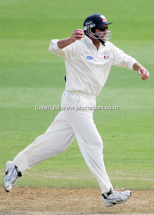 Richard Jones celebrates after catching Scott Baldwin out for a duck on day 4 of the State Championship cricket match between the Auckland Aces and the Central Stags at Eden Park, Auckland, New Zealand on Thursday 8 March 2007. Photo: Hannah Johnston/PHOTOSPORT<br />