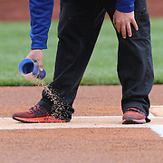 NEW YORK, NEW YORK - MAY 04:  Ground staff preparing home plate before the Atlanta Braves Vs New York Mets MLB regular season game at Citi Field on May 04, 2016 in New York City. (Photo by Tim Clayton/Corbis via Getty Images)