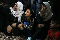September 29, 2018 - Gaza, Palestinian Territories, Palestine - Relatives of Palestinian boy Mohammed al-Hoam, 14, who was killed on Friday at the Israel-Gaza border fence, mourn during his funeral at the Buraij refugee camp in Gaza Strip September 29, 2018. (Credit Image: © Majdi Fathi/NurPhoto/ZUMA Press)