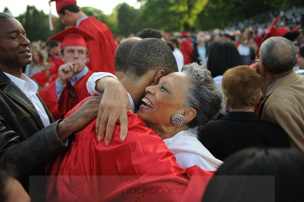 Herberto Distant (l) and Leslie Barron congratulate their nephew, Christopher Hansel, after Wellesley H.S.'s commencement ceremony, June 5, 2015.