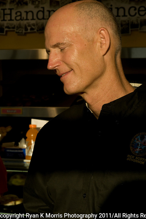"Florida Governor Rick Scott served doughnuts  to customers at NicolaÕs Donuts and Bakery in Tampa, FL as part of his ""workday"" initiative on Wednesday, August 3, 2011. The ""workdays""  mirror efforts of former Gov. and U.S. Sen. Bob Graham Bob Graham and are intended to allow the governor to spend time doing jobs with regular Floridians. .Photos by Ryan K. Morris"