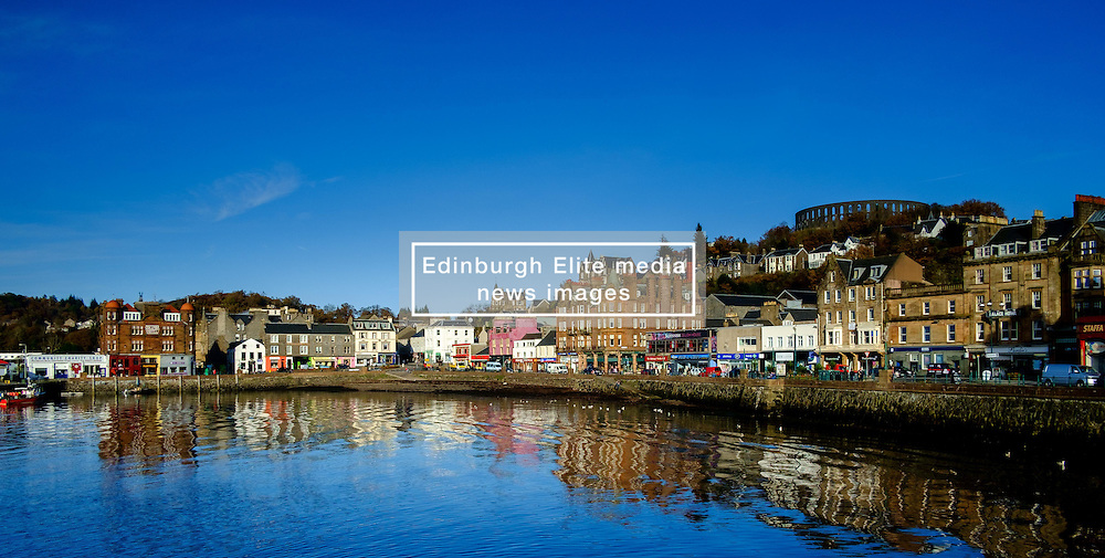 The sea front at Oban in Scotland with the ruined McCaig's Tower on the hill above<br /> <br /> (c) Andrew Wilson   Edinburgh Elite media
