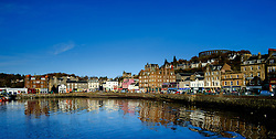 The sea front at Oban in Scotland with the ruined McCaig's Tower on the hill above<br /> <br /> (c) Andrew Wilson | Edinburgh Elite media