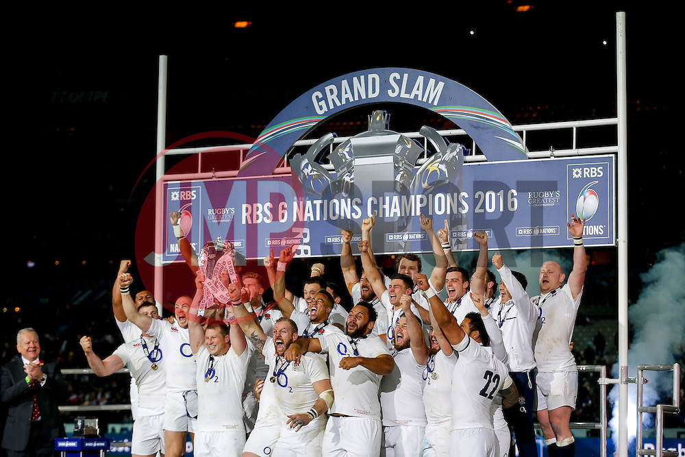 England Hooker Dylan Hartley (capt) lifts the Six Nations trophy as his side celebrate winning the match to complete their Six Nations title with the Grand Slam - Mandatory byline: Rogan Thomson/JMP - 19/03/2016 - RUGBY UNION - Stade de France - Paris, France - France v England - RBS 6 Nations 2016.