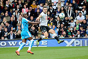 Derby County defender Jason Shackell clears from Wolverhampton Wanderers striker Benik Afobe during the Sky Bet Championship match between Derby County and Wolverhampton Wanderers at the iPro Stadium, Derby, England on 18 October 2015. Photo by Alan Franklin.
