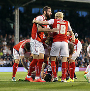 Matt Derbyshire injured whilst scoring, Rotherham celebration during the Sky Bet Championship match between Fulham and Rotherham United at Craven Cottage, London, England on 15 April 2015. Photo by Matthew Redman.
