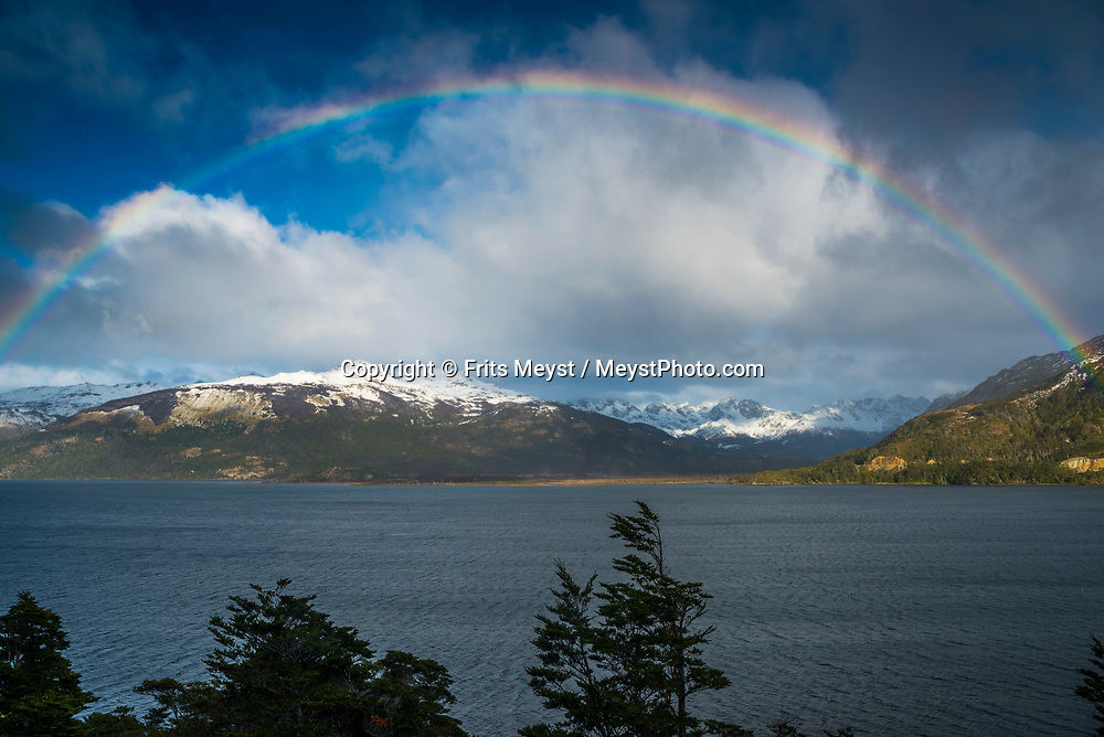 Porvenir, Tierra del Fuego, Chile, June 2017. Rainbow over Lago Fagnano. The windswept pampas of Southern Patagonia and Tierra del Fuego are truly among the one of the world's last frontiers. It was settled by European sheep farmers who have been carving out an existence in this barren land since the 19th century. In a race to control access to 'the end of the world' the Chilean government built a spectacular road, which now functions as the access to some of the last unexplored wildernesses on earth. Welcome to the Darwin Range, Karukinka National Park. Hiking, horseback riding and fly fishing awaits those who are ready for Adventure. Photo by Frits Meyst / MeystPhoto.com